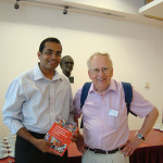 Dr-Vora-with-Prof-John-Stevenson---he-is-giving-him-a-book-gift